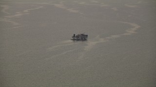 AF0001_000332 - HD stock footage aerial video of a small platform in Espiritu Santo Bay, Texas, sunrise