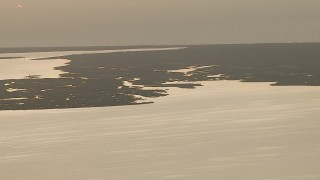 AF0001_000334 - Aerial stock footage of Flying by wetlands on the shore of Espiritu Santo Bay, Texas, sunrise