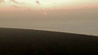 AF0001_000336 - HD stock footage aerial video of the rising sun visible from marshland by Gulf of Mexico, sunrise