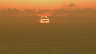 AF0001_000337 - HD stock footage aerial video of the sun rising behind clouds over the Gulf of Mexico
