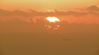 AF0001_000338 - HD stock footage aerial video of the sun rising behind clouds over oil tankers in the Gulf of Mexico