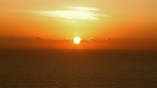AF0001_000342 - HD stock footage aerial video of a bright sunrise over the Gulf of Mexico