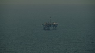 AF0001_000343 - HD stock footage aerial video of an oil derrick in the Gulf of Mexico at sunrise