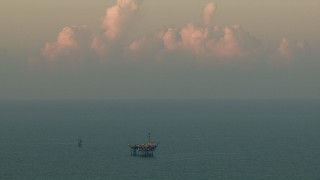 AF0001_000345 - HD stock footage aerial video flyby an oil rig in the Gulf of Mexico at sunrise