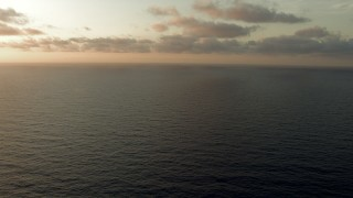 AF0001_000350 - HD stock footage aerial video fly low over the sea at sunrise, Gulf of Mexico