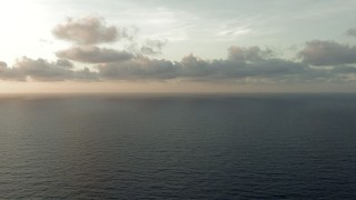 AF0001_000351 - Aerial stock footage of Flying between cloud and open sea at sunrise in the Gulf of Mexico