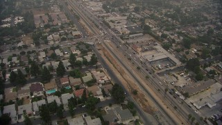 AF0001_000352 - HD stock footage aerial video of a reverse view of homes by San Fernando Road in Sylmar, California
