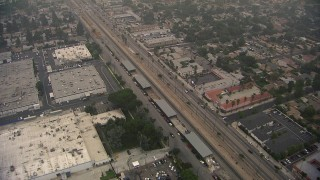 AF0001_000353 - HD stock footage aerial video of reverse view of warehouse buildings on San Fernando Road, Sylmar, California