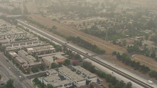 AF0001_000358 - HD stock footage aerial video of apartment buildings and cars on the 210 Freeway, Sylmar, California