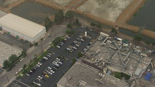 AF0001_000362 - HD stock footage aerial video of warehouses and a parking lot, San Fernando, California