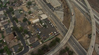 AF0001_000363 - HD stock footage aerial video reverse view of the 210 / 118 Freeway interchange, San Fernando, California