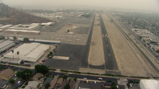 AF0001_000366 - HD stock footage aerial video of approaching the runway at Whiteman Airport, Pacoima, California