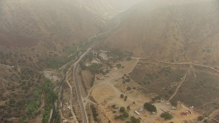 AF0001_000370 - HD stock footage aerial video of a bird's eye view of Big Tujunga Canyon Road and Camp Luis Roth, Tujunga, California