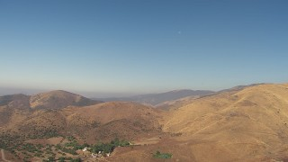 AF0001_000387 - HD stock footage aerial video of rural homes near dry hills in Agua Dulce, California