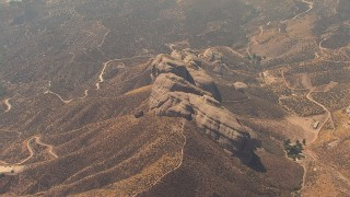 AF0001_000394 - HD stock footage aerial video approach rock formation in Agua Dulce, California