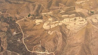 AF0001_000395 - HD stock footage aerial video tilt to a bird's eye view of rock formations near Agua Dulce, California