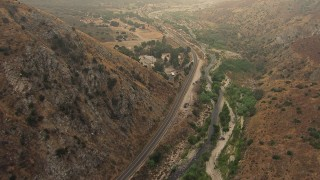 AF0001_000410 - HD stock footage aerial video of following Big Tujunga Canyon Road to reveal rural homes, Rancho Tujunga, California