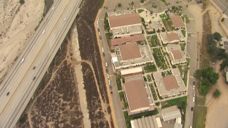 AF0001_000414 - HD stock footage aerial video of bird's eye view of All Nations Church and the 210 Freeway, reveal greenhouses in Lake View Terrace, California