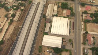 AF0001_000415 - HD stock footage aerial video of bird's eye view of greenhouses and homes by the 210 Freeway, Lake View Terrace, California