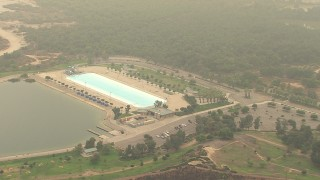 AF0001_000417 - HD stock footage aerial video of flying by Hansen Dam Aquatic Center in Lake View Terrace, California