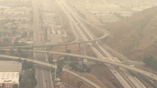 AF0001_000418 - HD stock footage aerial video of light traffic on the 210 / 118 Freeway interchange in Pacoima, California