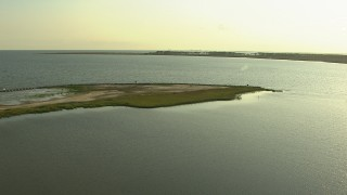 AF0001_000425 - HD stock footage aerial video fly over bay to approach marshland, Gulf Coast, Alabama, twilight
