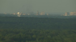 AF0001_000444 - HD stock footage aerial video of water tower and oil refinery at sunset in the Gulf Coast, Alabama