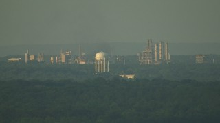 AF0001_000445 - HD stock footage aerial video of water tower and refinery at sunset, pan to reveal factory in the Gulf Coast, Alabama