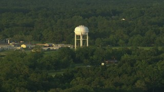 AF0001_000446 - HD stock footage aerial video of a water tower and rural neighborhood at sunset in the Gulf Coast, Alabama