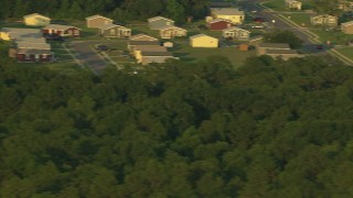 AF0001_000447 - HD stock footage aerial video flyby rural homes at sunset to reveal farm fields, Gulf Coast, Alabama