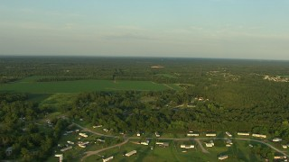 AF0001_000448 - HD stock footage aerial video flyby rural homes and farm fields at sunset, Gulf Coast, Alabama
