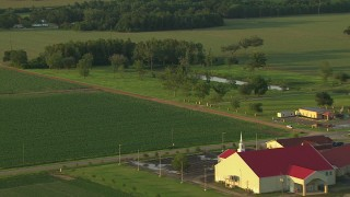 AF0001_000450 - HD stock footage aerial video flyby small rural church and crop fields at sunset, Gulf Coast, Alabama