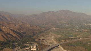 AF0001_000451 - HD stock footage aerial video of following Interstate 210 to approach the San Gabriel Mountains, Sunland, California