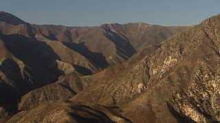 AF0001_000462 - HD stock footage aerial video approach tall mountain ridge in the San Gabriel Mountains, California, sunset