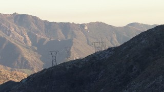 AF0001_000475 - HD stock footage aerial video approach and follow power lines up mountain mountain slope, San Gabriel Mountains, California