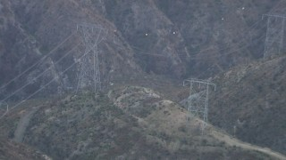 AF0001_000477 - HD stock footage aerial video of power lines spanning a mountain canyon in the San Gabriel Mountains, California