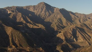AF0001_000485 - HD stock footage aerial video approach a rugged peak in the San Gabriel Mountains, California
