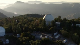 AF0001_000493 - HD stock footage aerial video orbit a telescope at the Mount Wilson Observatory, San Gabriel Mountains, California, sunset