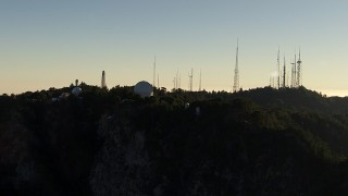 AF0001_000494 - HD stock footage aerial video flyby the Mount Wilson Observatory and radio towers in the San Gabriel Mountains, California, twilight