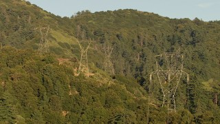 AF0001_000501 - HD stock footage aerial video of flying by a group of power line towers in the San Gabriel Mountains, California