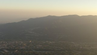 AF0001_000512 - HD stock footage aerial video of I-210 / 2 interchange, hospital and suburban homes in La Cañada Flintridge, California, sunset