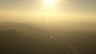 AF0001_000514 - HD stock footage aerial video of the setting sun above the Verdugo Mountains, La Crescenta-Montrose, California