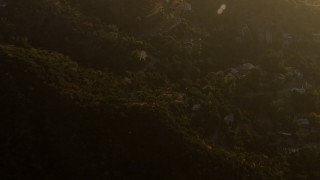 AF0001_000515 - HD stock footage aerial video tilt from hillside homes in the Verdugo Mountains, Tujunga, California, sunset