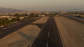 AF0001_000520 - HD stock footage aerial video approach and fly over the runway at Whiteman Airport, Pacoima, California, sunset