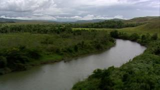 AF0001_000521 - HD stock footage aerial video of following a river through a savanna, Southern Venezuela