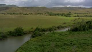 AF0001_000522 - HD stock footage aerial video follow a narrow river through green savanna, Southern Venezuela