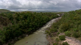 AF0001_000532 - HD stock footage aerial video fly low over the river to approach waterfalls in Southern Venezuela