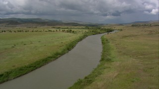 AF0001_000533 - HD stock footage aerial video pan across a river and palm trees in the savanna, Southern Venezuela