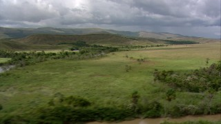 AF0001_000535 - HD stock footage aerial video flyby a river in the savanna near green hills in Southern Venezuela