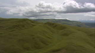 AF0001_000551 - HD stock footage aerial video flyby grassy hills to reveal mountains in the distance, Southern Venezuela